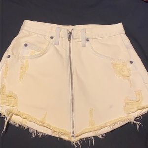 Yellow jean skirt with zipper down the front